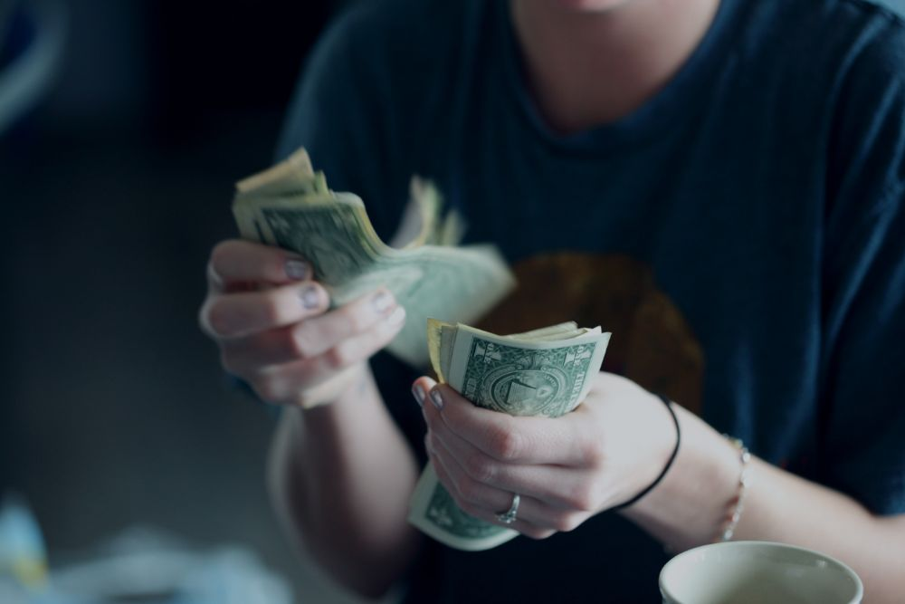 Woman with hand full of cash